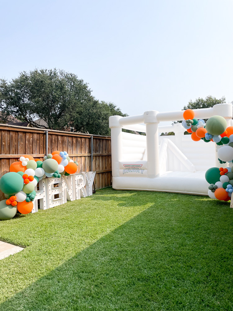 henry marquee sign white bounce house balloon garlands