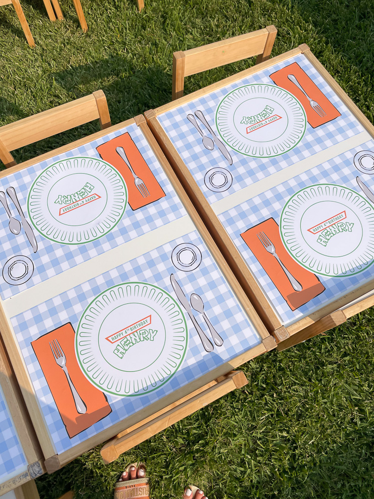 kids table with blue and white gingham paper placemats and custom henry plates