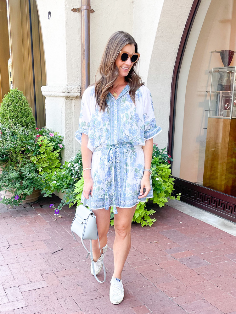 woman in blue floral dress