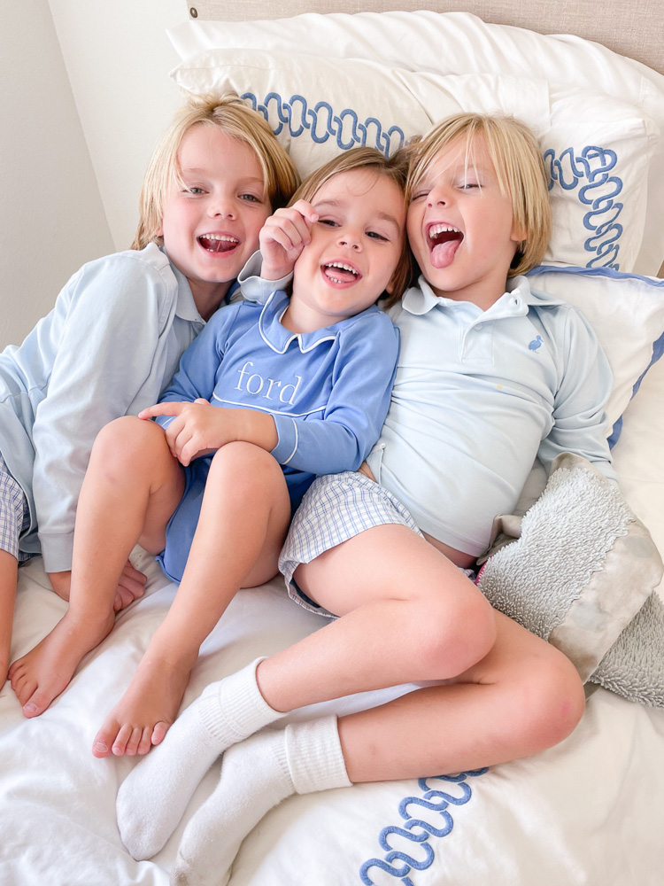 three young brothers laughing together