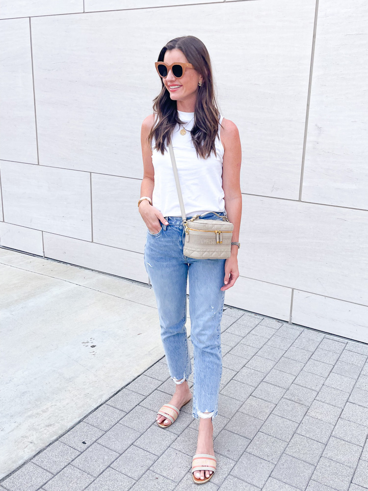 woman wearing jeans white t-shirt and tan crossbody bag