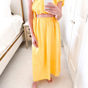 yellow two piece maxi skirt and one shoulder top