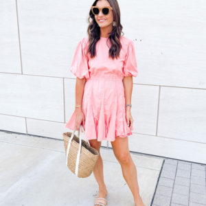 woman wearing coral puff sleeve mini dress